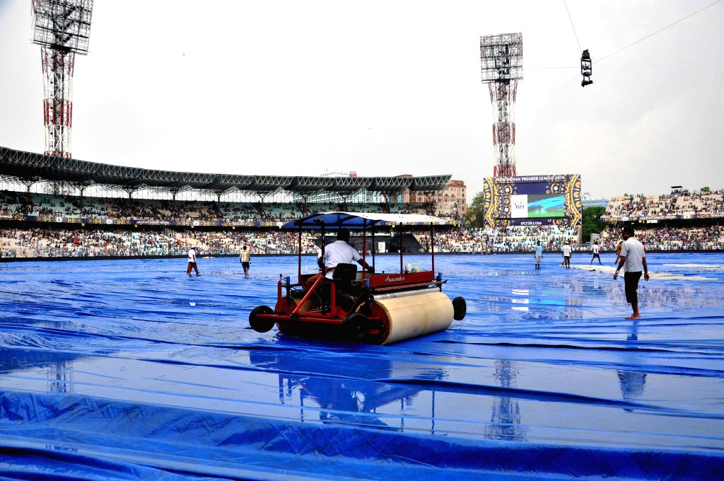 The super sopper out in action at the Eden Gardens after rains disrupted an IPL-2015 match between Kolkata Knight Riders (KKR) and Rajasthan Royals (RR) in Kolkata on April 26, 2015.