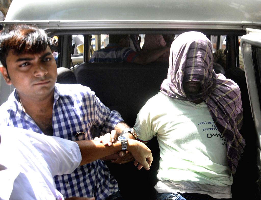 The two men who shot at a policeman being taken to be produced before a Kolkata court on April 20, 2015.