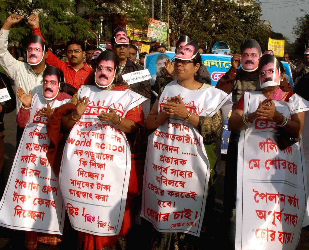 The victims of chit fund scams participate in a rally to protest against the West Bengal Government in Kolkata, on Jan 21, 2015.