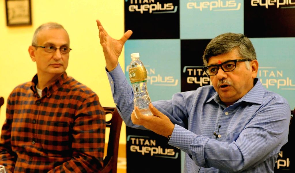 Kolkata: Titan Industries MD Bhaskar Bhattacharya (R) addresses at the launch of a lens manufacturing facility in Kolkata on May 11, 2016. Also seen Titan Eyewear CEO Ronnie Talati. (Photo: IANS)