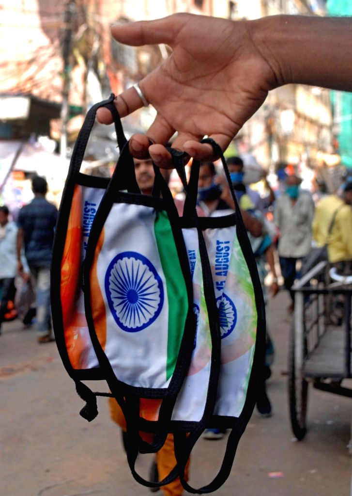 Kolkata : Tricolored face masks on sale on the occasion of the 74th Independence Day, amid COVID-19 pandemic in Kolkata on Aug 15, 2020.