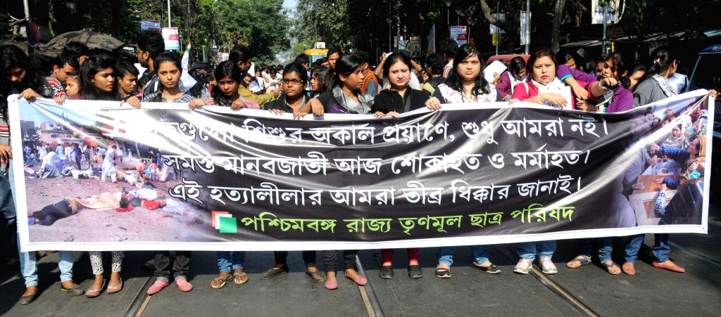 Trinamool Congress Chatra Parishad activists stage a demonstration to protest against Tuesday's attack on the Army Public School in Peshawar, Pakistan, that claimed 148 lives mostly those of