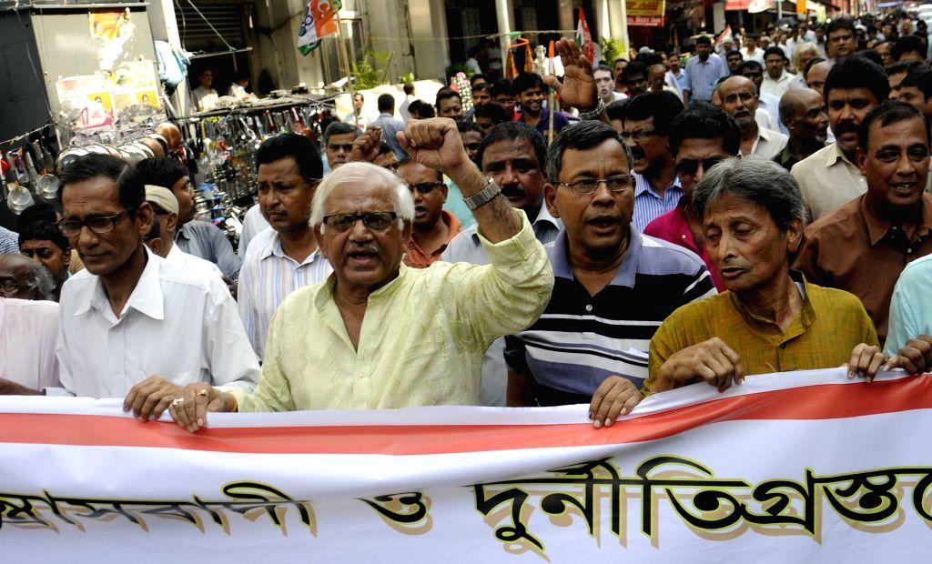Trinamool Congress leader Sovandeb Chattopadhyay leads a rally in Kolkata on April 29, 2015.