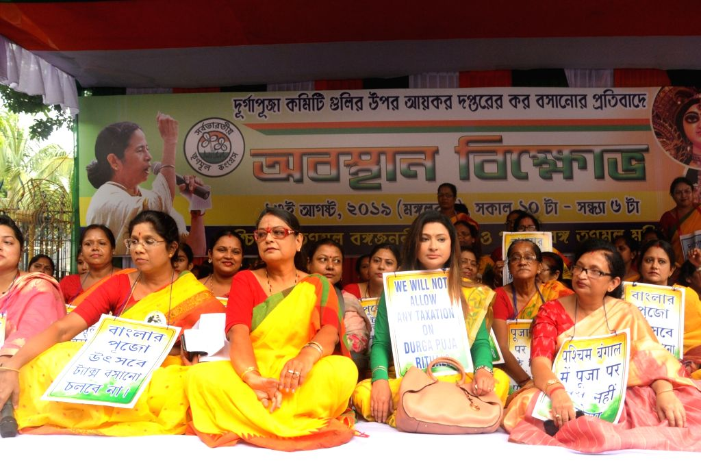 Kolkata: Trinamool Congress leaders stage a demonstration against Income Tax Department's notice issued to Durga Puja committees in Kolkata on Aug 13, 2019. (Photo: IANS)