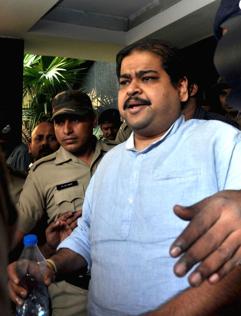 Trinamool Congress MP Srinjoy Bose being produce at court in connection with multi-crore-rupee Saradha chit fund scam in Kolkata, on Nov 22, 2014.