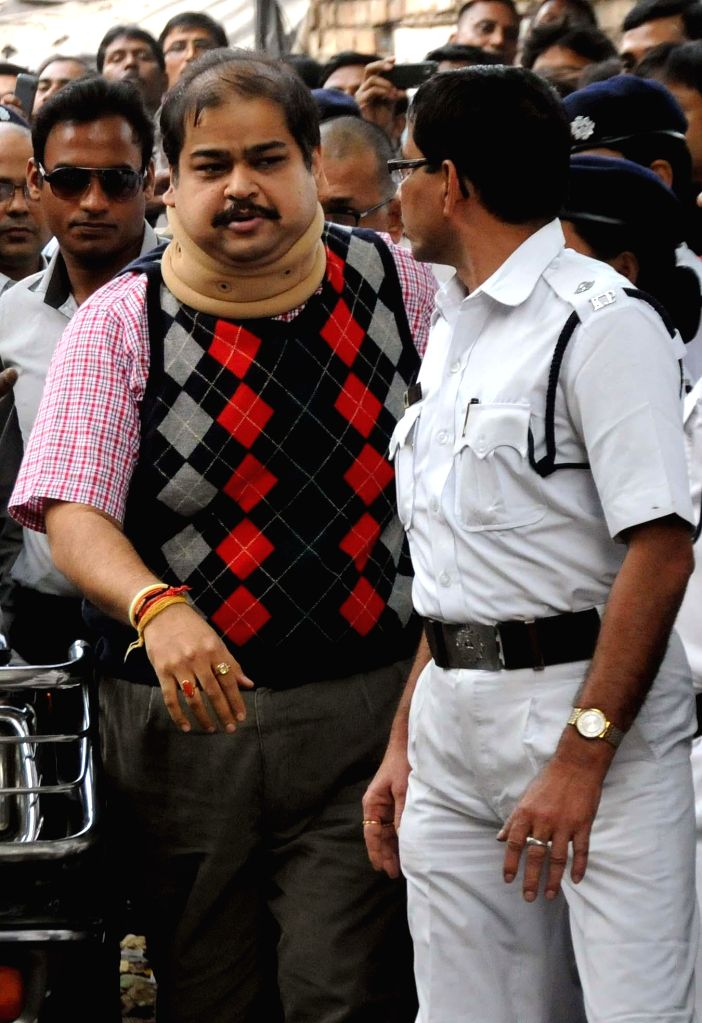 Trinamool Congress MP Srinjoy Bose being taken to be produced before a Kolkata court in connection with multi-crore-rupee Saradha chit fund scam in Kolkata, on Nov 21, 2014.