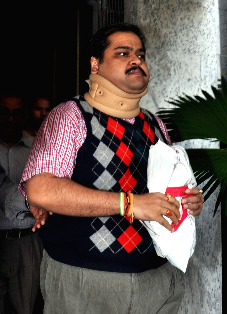 Trinamool Congress MP Srinjoy Bose being taken to be produced before a Kolkata court from CBI office, in connection with multi-crore-rupee Saradha chit fund scam in Kolkata, on Nov 21, 2014.