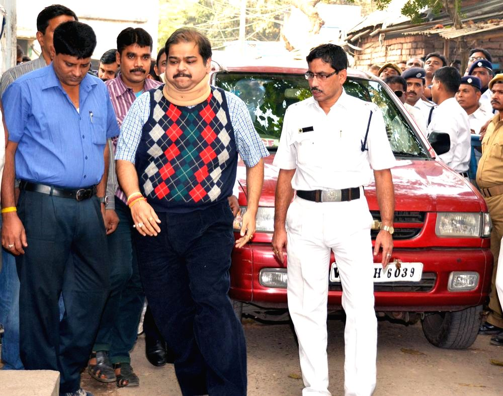 Trinamool Congress MP Srinjoy Bose being taken to be produced before a Kolkata court in connection with multi-crore-rupee Saradha chit fund scam in Kolkata on Nov 29, 2014.