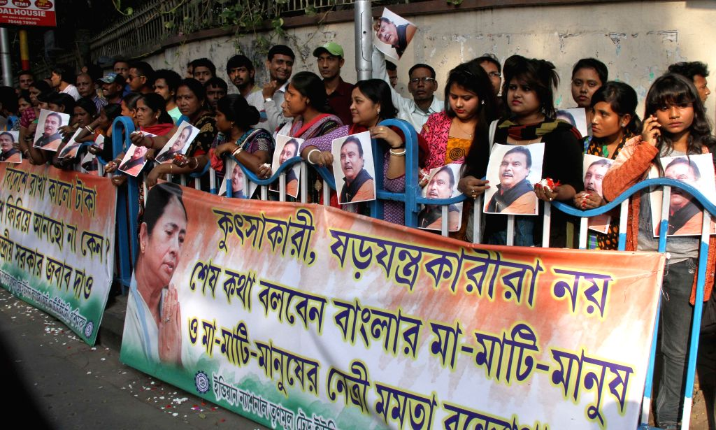 Trinamool Congress workers demonstrate to press for the release of West Bengal Transport Minister and party leader Madan Mitra  in Kolkata, on Dec 16, 2014.