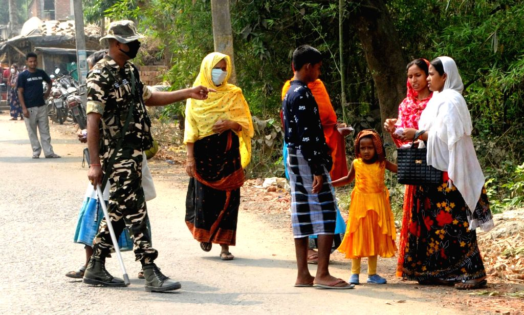 Kolkata : Voters outside a polling station to cast their vote during the 4th phase of State Assembly election in South 24 Pargana district near Kolkata On Saturday, April 10th, 2021.(photo: Kuntal ...