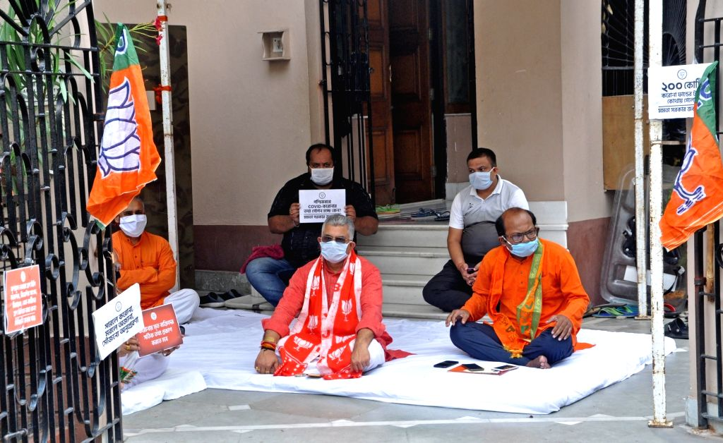 Kolkata: West Bengal BJP President Dilip Ghosh stages a sit-in demonstration against the State Government over the current situation of COVID 19 pandemic and related issues, at his residence in Kolkata during the extended nationwide lockdown imposed  - Dilip Ghosh