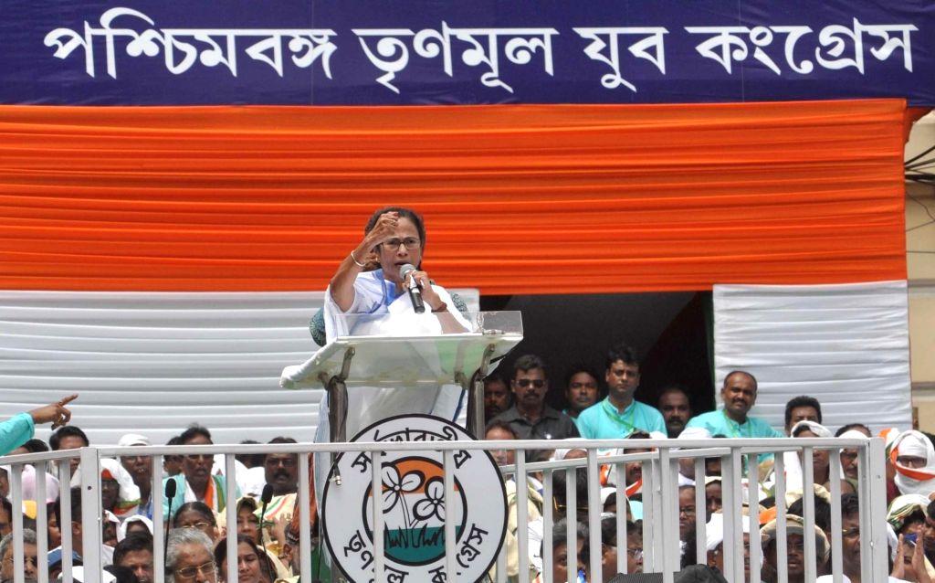 Kolkata: West Bengal Chief Minister and TMC Supremo Mamata Banerjee addresses during party's annual Martyrs' Day rally in Kolkata on July 21, 2019. (Photo: Kuntal Chakrabarty/IANS) - Mamata Banerjee