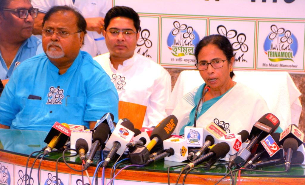 Kolkata: West Bengal Chief Minister and TMC supremo Mamata Banerjee addresses a press conference at the launch of the party's manifesto ahead of 2019 Lok Sabha elections in Kolkata, on March 27, 2019. Also seen TMC leaders - state cabinet minister Pa - Partha Chatterjee, Mamata Banerjee and Abhishek Banerjee