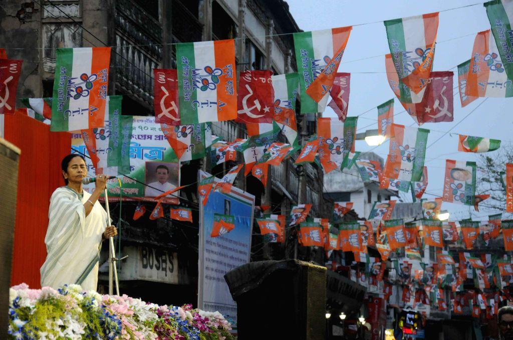 West Bengal Chief Minister and Trinamool Congress supremo Mamata Banerjee addresses at a public meeting ahead of Kolkata Municipal Corporation Polls in Kolkata, on April 13, 2015.