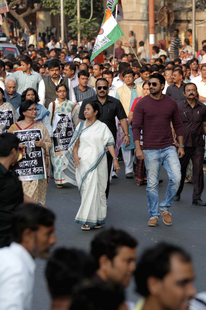 West Bengal Chief Minister Mamata Banerjee leads a rally to protest against central government in Kolkata, on Nov 24, 2014. Also seen Trinamool Congress MP, actor Dev and others.