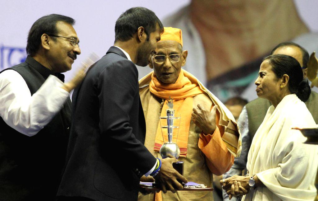 West Bengal Chief Minister Mamata Banerjee during Vivek Chetna Utsav ahead of 152 Birth anniversary of Swami Vivekananda in Kolkata, on Jan 10, 2015. Also seen West Bengal minister Arup ...