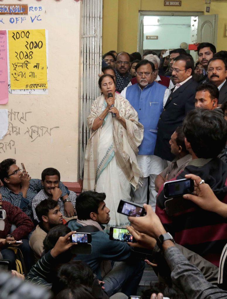 West Bengal Chief Minister Mamata Banerjee announces resignation of Jadavpur University Vice Chancellor Abhijit Chakrabarti at the varsity campus in Kolkata, on Jan 12, 2015. - Mamata Banerjee