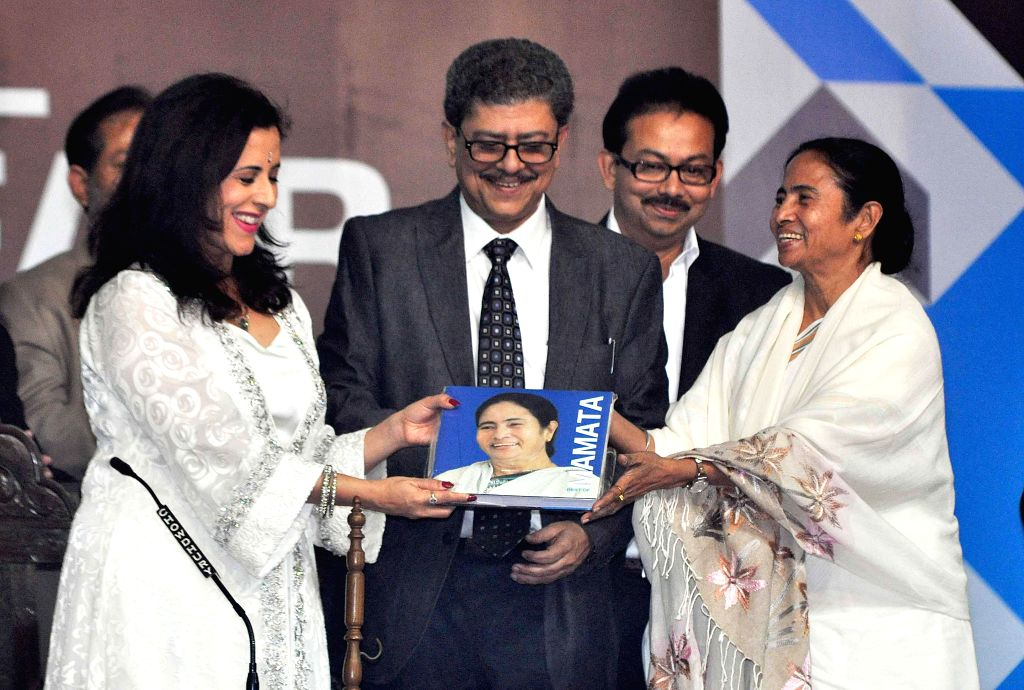 West Bengal Chief Minister Mamata Banerjee, British author Anita Anand with other guests release a book during inauguration of 39th International Kolkata Book Fair in Kolkata on Jan 27, ... - Mamata Banerjee