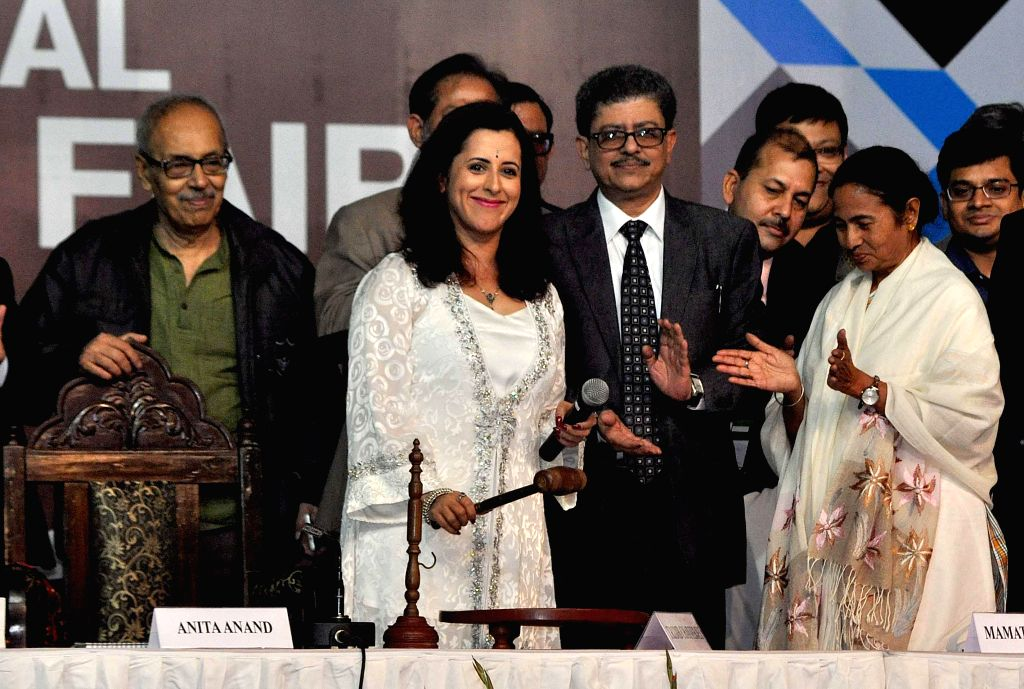 West Bengal Chief Minister Mamata Banerjee, British author Anita Anand, author Sirsendu Mukherjee with other guests during inauguration of 39th International Kolkata Book Fair in Kolkata on . - Mamata Banerjee and Sirsendu Mukherjee