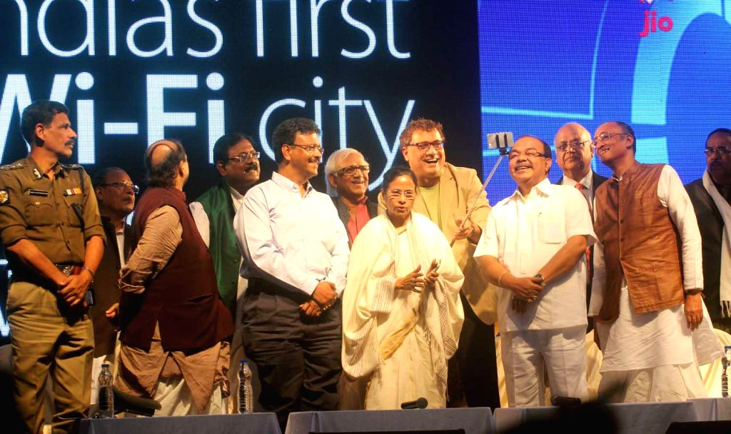 West Bengal Chief Minister Mamata Banerjee, Mayor Shovon Chatterjee, Finance Minister Amit Mitra and others during the inauguration of first Wi-Fi city in Kolkata on Feb 5, 2015. - Mamata Banerjee and Shovon Chatterjee