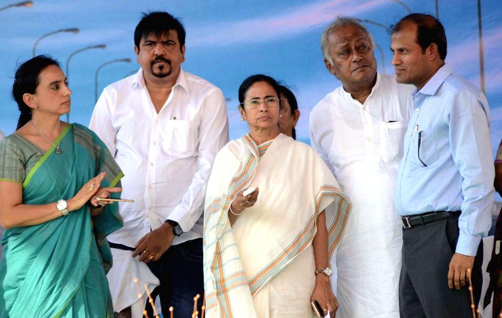 West Bengal Chief Minister Mamata Banerjee during inauguration of a flyover constructed on VIP Road in Kolkata, on March 8, 2015. Also seen Trinamool Congress leader Sougata Roy and others. - Mamata Banerjee and Sougata Roy