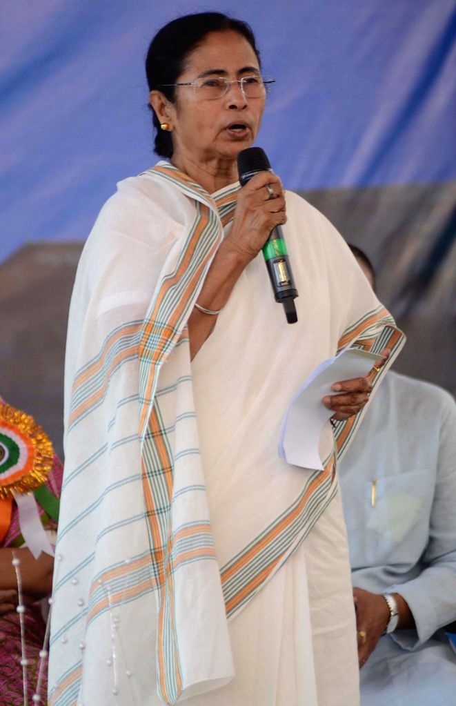 West Bengal Chief Minister Mamata Banerjee addresses during inauguration of a flyover constructed on VIP Road in Kolkata, on March 8, 2015. - Mamata Banerjee