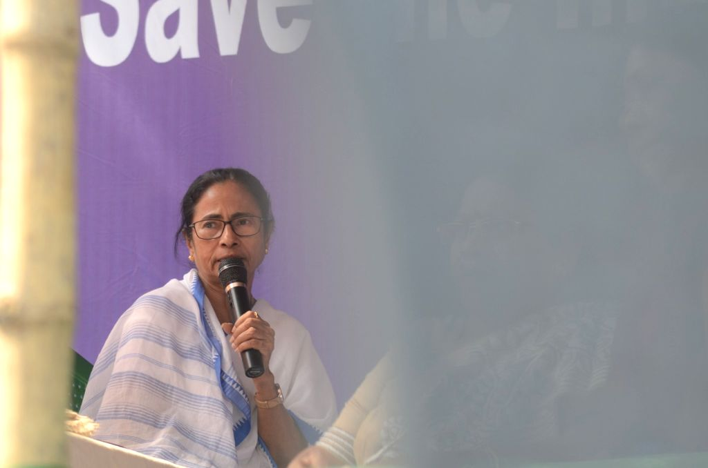 Kolkata: West Bengal Chief Minister Mamata Banerjee addresses during a sit-in (dharna) protest over the CBI's attempt to question Kolkata Police Commissioner Rajeev Kumar in connection with a ponzi scheme scam, near the Metro Channel in Kolkata on Fe - Mamata Banerjee