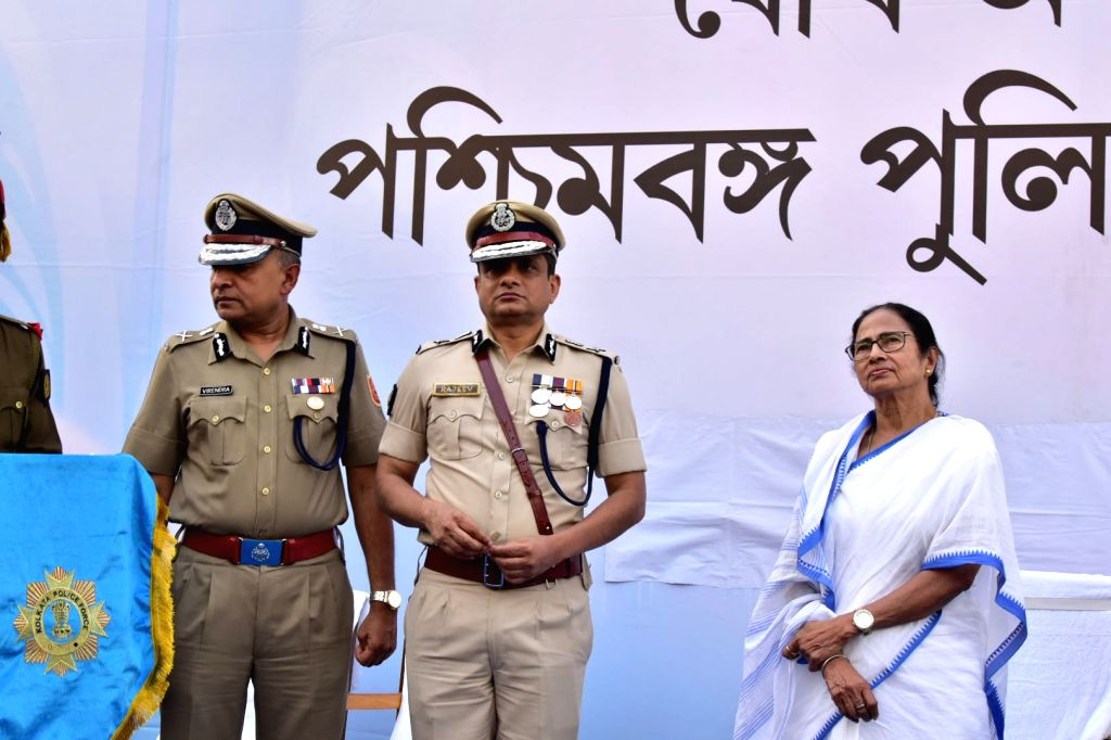 Kolkata: West Bengal Chief Minister Mamata Banerjee and Kolkata Police Commissioner Rajeev Kumar during the Joint Investiture ceremony of West Bengal Police and Kolkata Police, on Feb 4, 2019. (Photo: IANS) - Mamata Banerjee