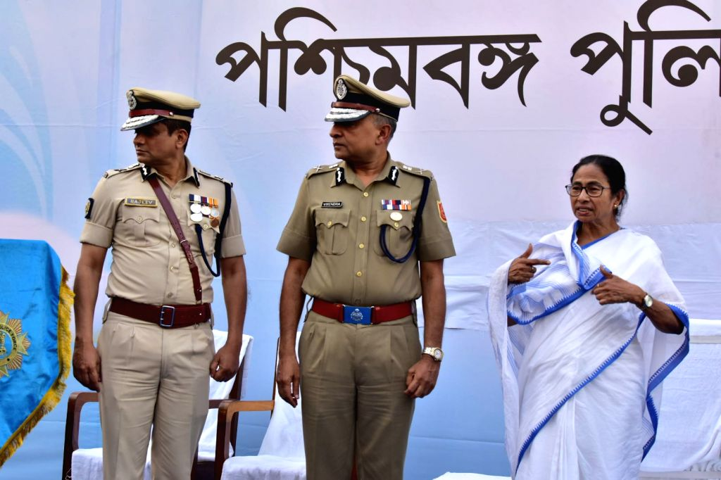 Kolkata: West Bengal Chief Minister Mamata Banerjee and Kolkata Police Commissioner Rajeev Kumar during the Joint Investiture ceremony of West Bengal Police and Kolkata Police, on Feb 4, 2019. (Photo: IANS) - Mamata Banerjee