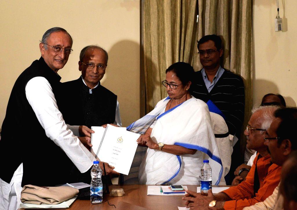 Kolkata: West Bengal Chief Minister Mamata Banerjee and state Finance Minister Amit Mitra during a cabinet meeting in Kolkata, on Feb 4, 2019. (Photo: IANS) - Mamata Banerjee