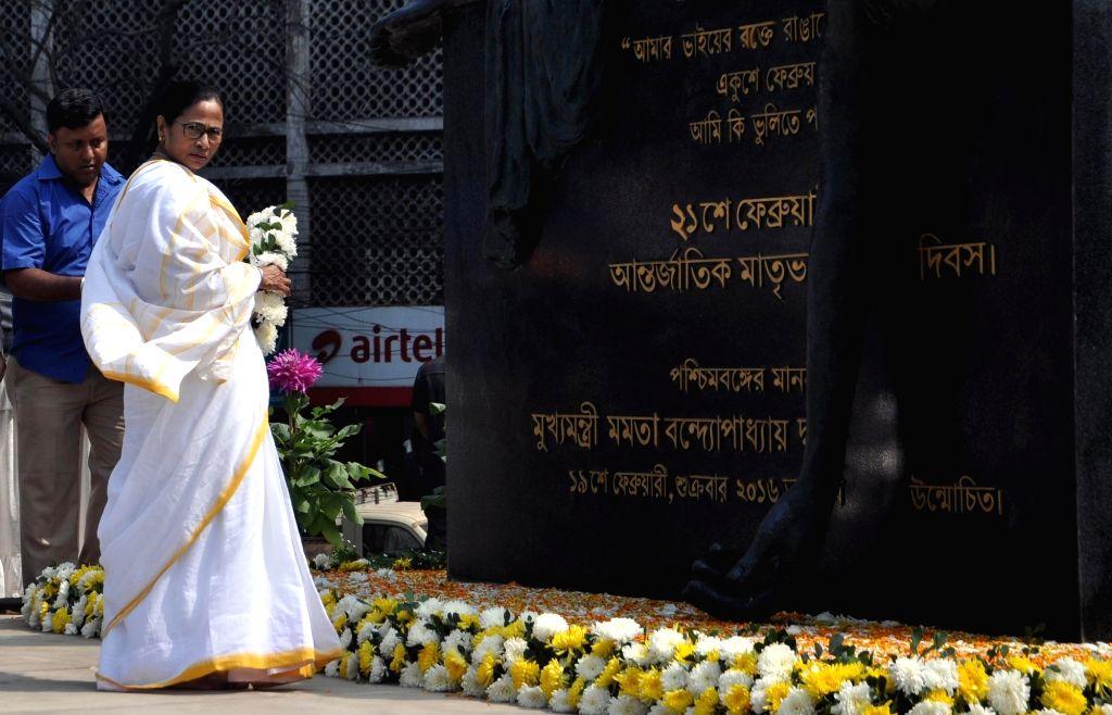 Kolkata: West Bengal Chief Minister Mamata Banerjee during a programme organised on International Mother Language Day in Kolkata, on Feb 21, 2019. (Photo: Kuntal Chakrabarty/IANS) - Mamata Banerjee