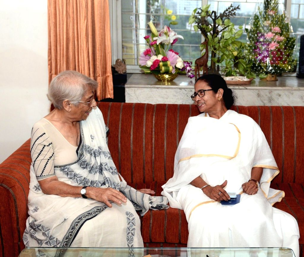 Kolkata: West Bengal Chief Minister Mamata Banerjee meets Nirmala Banerjee, mother of Nobel Prize in Economics winner Abhijit Vinayak Banerjee, in Kolkata on Oct 16, 2019. Banerjee said her government was keen to utilise his services as also that of  - Mamata Banerjee, Nirmala Banerjee and Abhijit Vinayak Banerjee