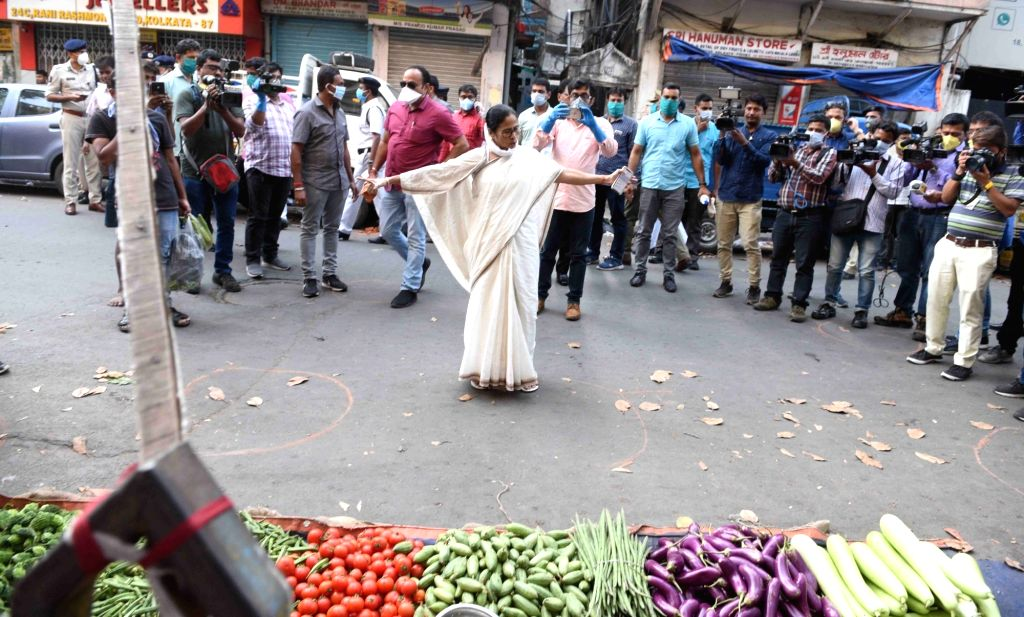Kolkata: West Bengal Chief Minister Mamata Banerjee urges people to stringently follow social distancing on Day 2 of the 21-day nationwide lockdown imposed by the Narendra Modi government over the coronavirus pandemic; in Kolkata on March 26, 2020. ( - Mamata Banerjee and Narendra Modi