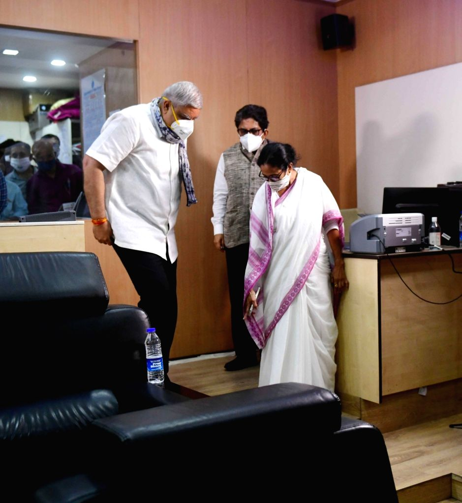 Kolkata:  West Bengal Chief Minister Mamata Banerjee with Governor of West Bengal Jagdeep Dhankhar along with Government officials attending the Control room for watching the situation of upcoming strom cyclone Yaas at Nabanna on Howrah  in Kolkata   - Mamata Banerjee