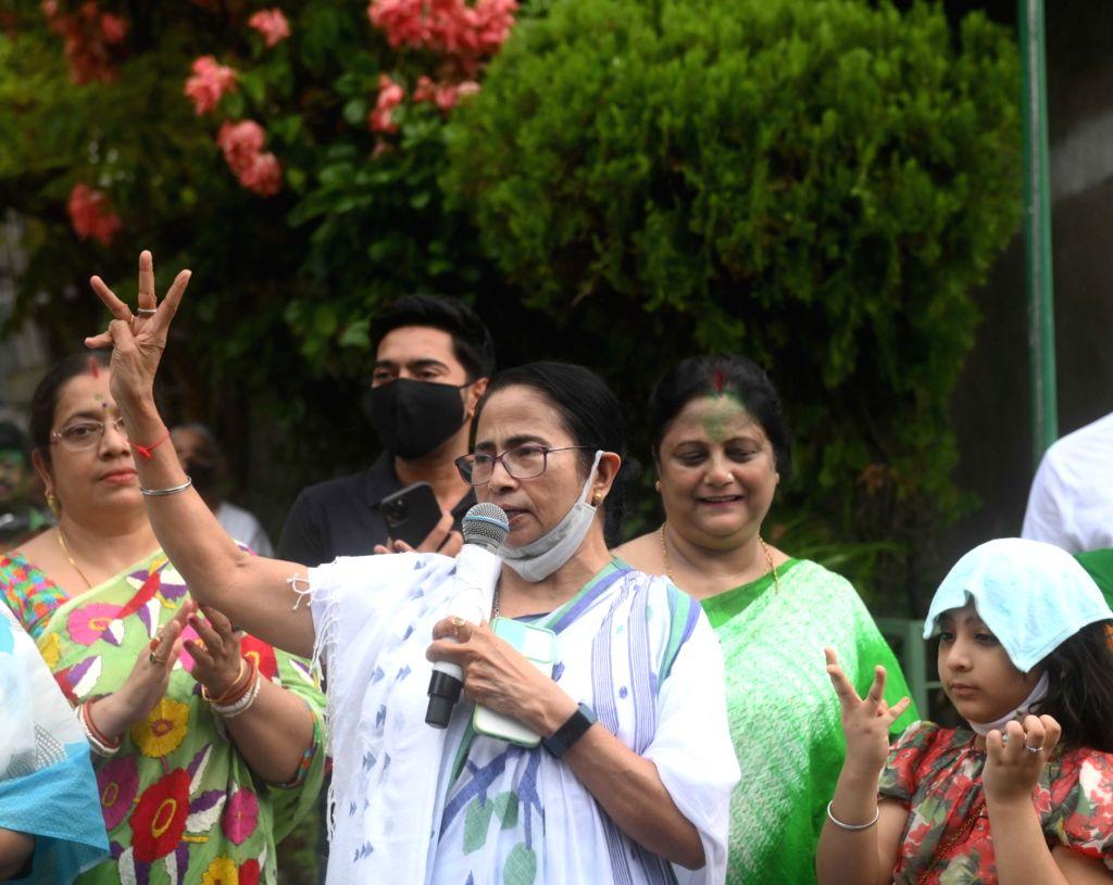 Kolkata: West Bengal Chief Minister Mamata Banerjee with Party General Secretary Abhishek Banerjee showing victory sign after winning bhawanipur by election in Kolkata on Sunday october 03, 2021.(Photo/IANS) - Mamata Banerjee