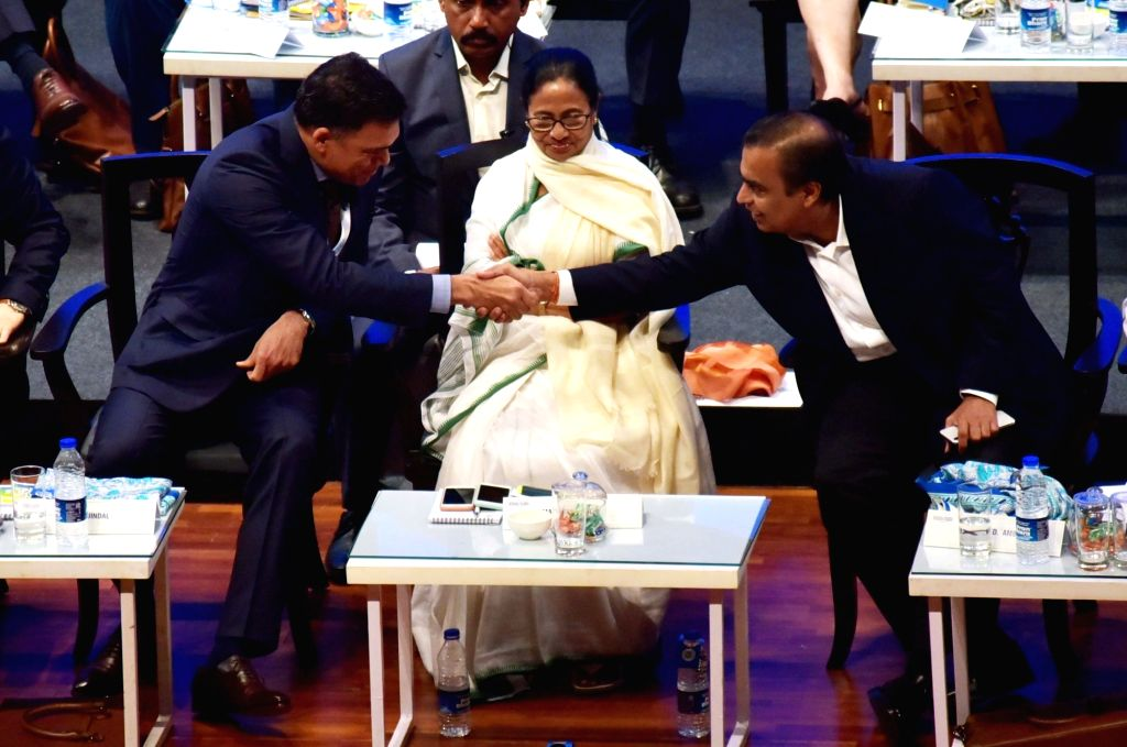 Kolkata: West Bengal Chief Minister Mamata Banerjee with Reliance Industries Chairman and Managing Director Mukesh Ambani and JSW Group Chairman Sajjan Jindal at Bengal Global Business Summit (BGBS) 2019 in Kolkata, on Feb 7, 2019. (Photo: Kuntal Cha - Mamata Banerjee and Mukesh Ambani