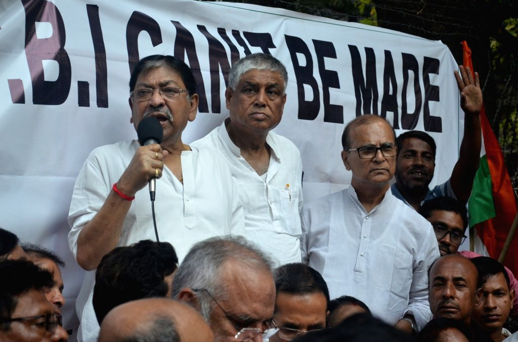 :Kolkata: West Bengal Congress President Somendra Nath Mitra addresses during a protest rally organised by the party against the BJP-Government over recent developments pertaining to the ...