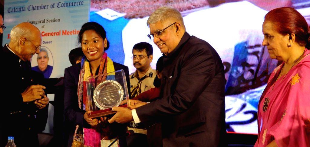 Kolkata: West Bengal Governor Jagdeep Dhankhar felicitates heptathlete Swapna Barman at the 188th Annual General Meeting of Calcutta Chamber of Commerce, in Kolkata on Sep 26, 2019. (Photo: IANS)