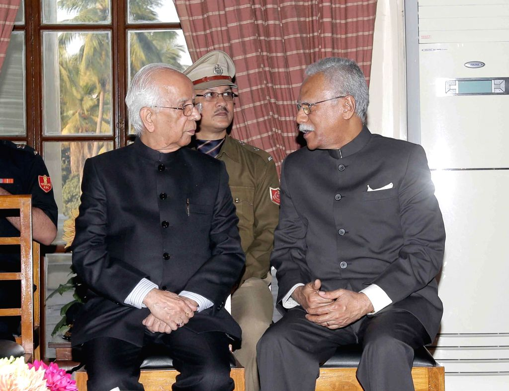 West Bengal Governor K N Tripathi with newly appointed State Chief Information Commissioner West Bengal, K John Koshy at Rajbhavan in Kolkata on Feb. 3, 2015. - K N Tripathi