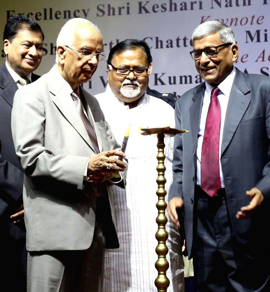 West Bengal Governor Keshari Nath Tripathi with West Bengal Education Minister Partha Chatterjee and industrialist  H.P. Budhia during inauguration of a conclave on education and cultural ... - Partha Chatterjee and Keshari Nath Tripathi