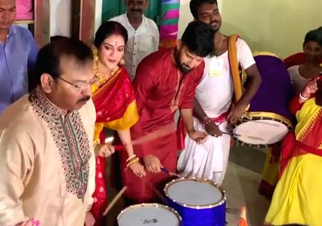 Kolkata: West Bengal Minister Aroop Biswas, actress and Trinamool Congress MP Nusrat Jahan and her husband Nikhil Jain beat 'dhaak' - drums -  at a Durga Puja pandal in Kolkata on Oct 7, 2019. (Photo: IANS) - Aroop Biswas and Nikhil Jain