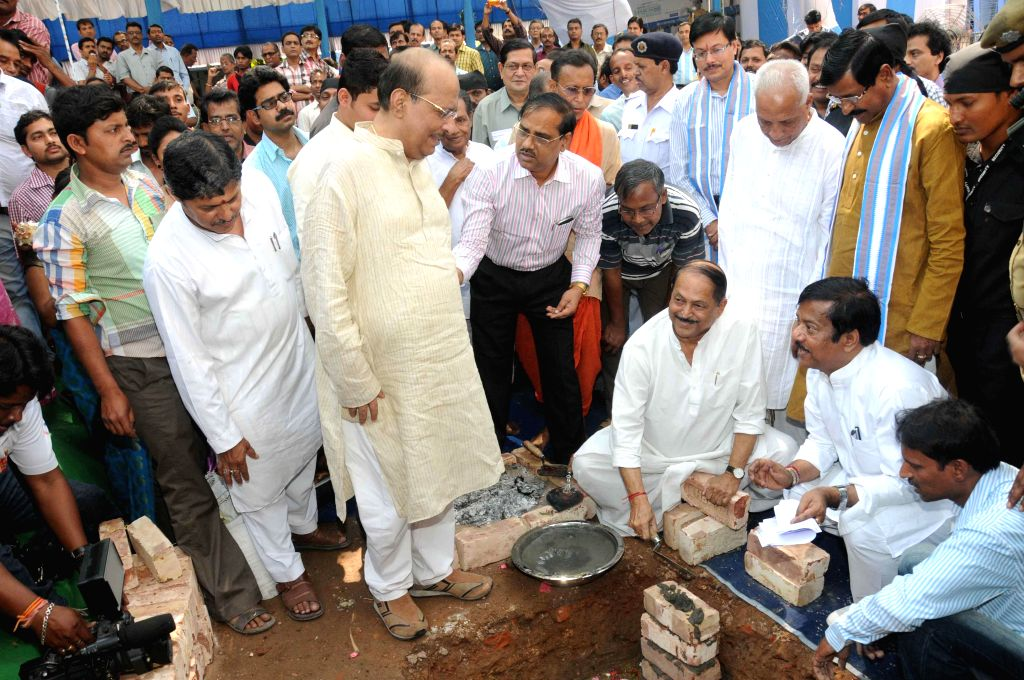 West Bengal Panchayat Minister Subrata Mukherjee lays the foundation stone of a new building of the Department of Food and Supplies of West Bengal in Kolkata on March 13, 2015. Also seen ...