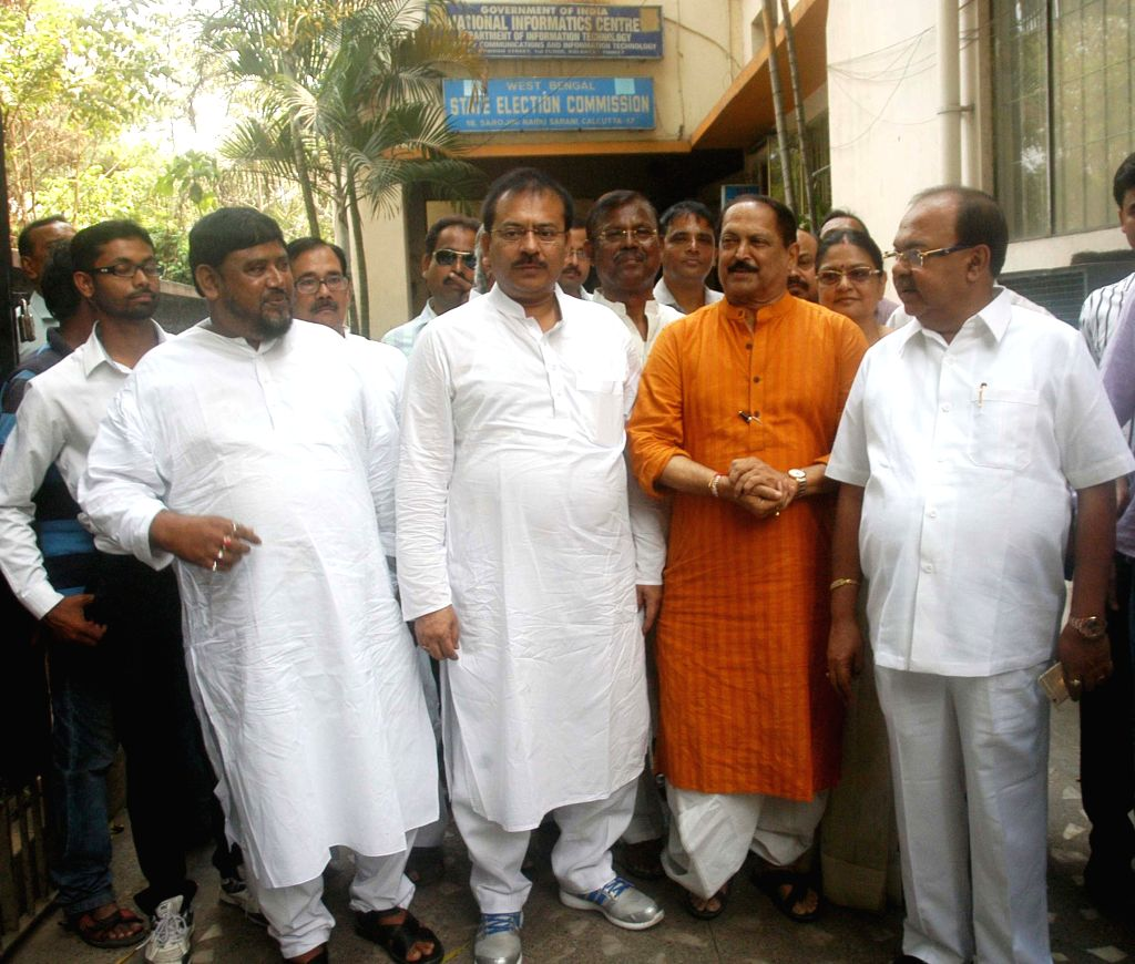 West Bengal Panchayat Minister Subrata Mukherjee, Housing and Youth Affairs Minister Arup Biswas and Kolkata Mayor Sovan Chatterjee arrive to the State Election Commission's office for ... - Subrata Mukherjee and Mayor Sovan Chatterjee
