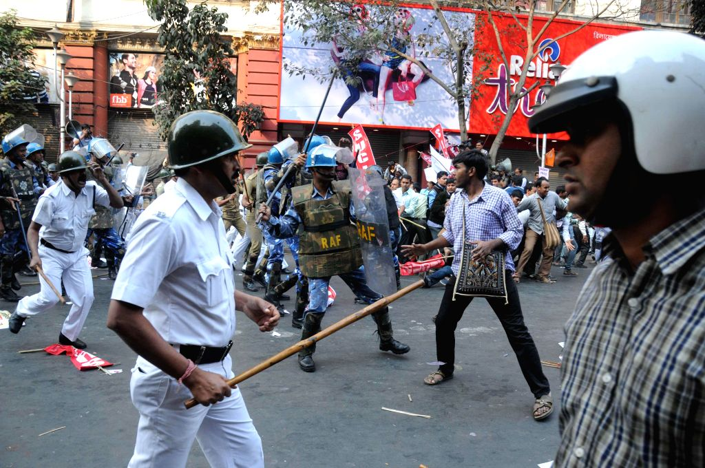 West Bengal Police personnel lathi charge SUCI activists as they demonstrate against the West Bengal Government in Kolkata on Feb 5, 2015.