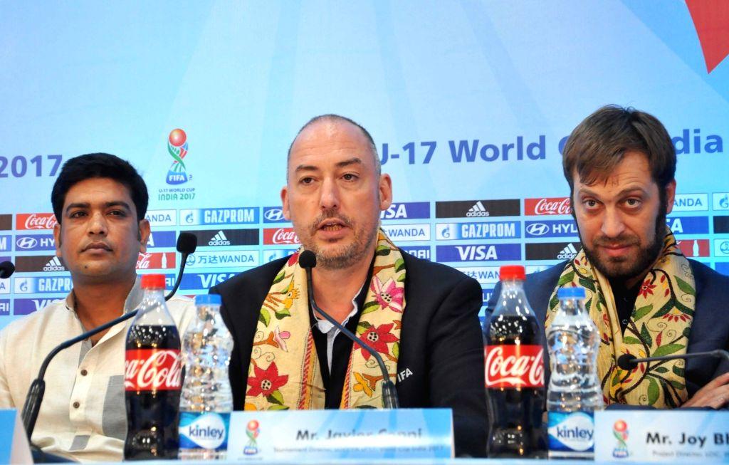 Kolkata: West Bengal Sports Minister Laxmi Ratan Shukla, FIFA Head of Tournaments U-17 World Cup Jaime Yarza and FIFA U-17 World Cup India 2017 Tournament Director Javier Ceppi during a ... - Laxmi Ratan Shukla