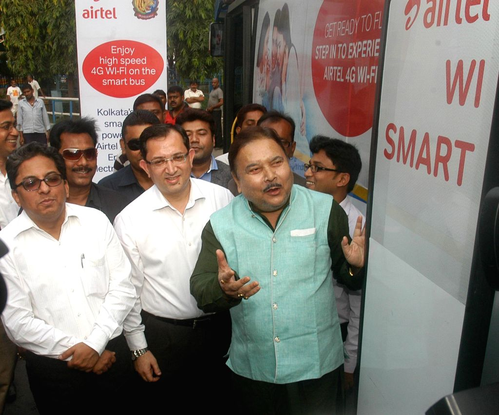 West Bengal Transport Minister Madan Mitra launches a wifi enabled Smart Bus service in Kolkata, on Nov 5, 2014. - Madan Mitra