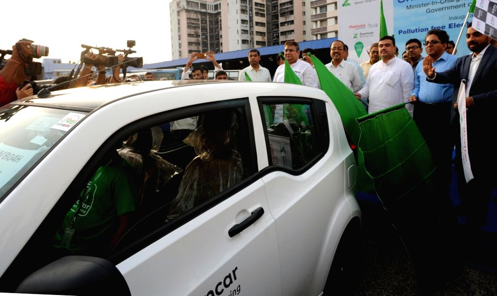Kolkata: West Bengal Transport Minister Suvendu Adhikari, Mahindra Electrics CEO Mahesh Babu and ZoomcarCo-Founder and CEO Greg Moran launch  Mahindra electric vehicles on Zoomcar in ... - Suvendu Adhikari
