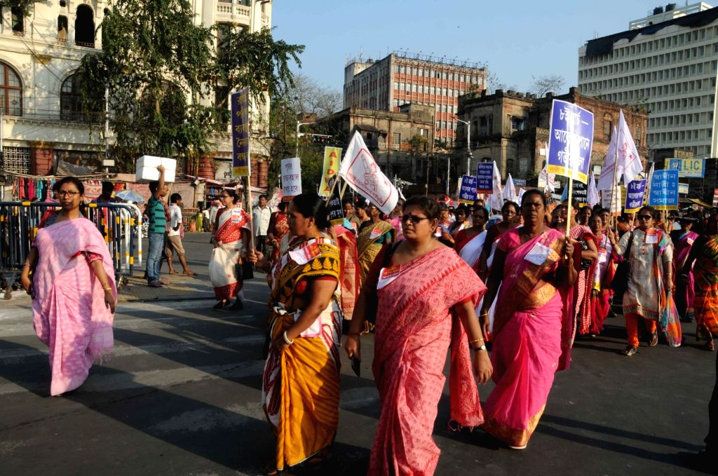 Kolkata: Women affiliated to various leftist organisations participate in a march organised on International Women's Day in Kolkata, on March 8, 2019. (Photo: IANS)