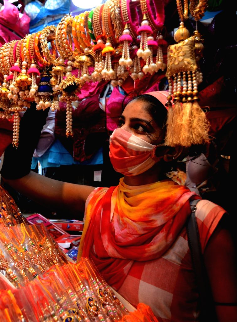Kolkata : Women busy shopping ahead of Raksha Bandhan celebrations, in Kolkata on July 30, 2020.