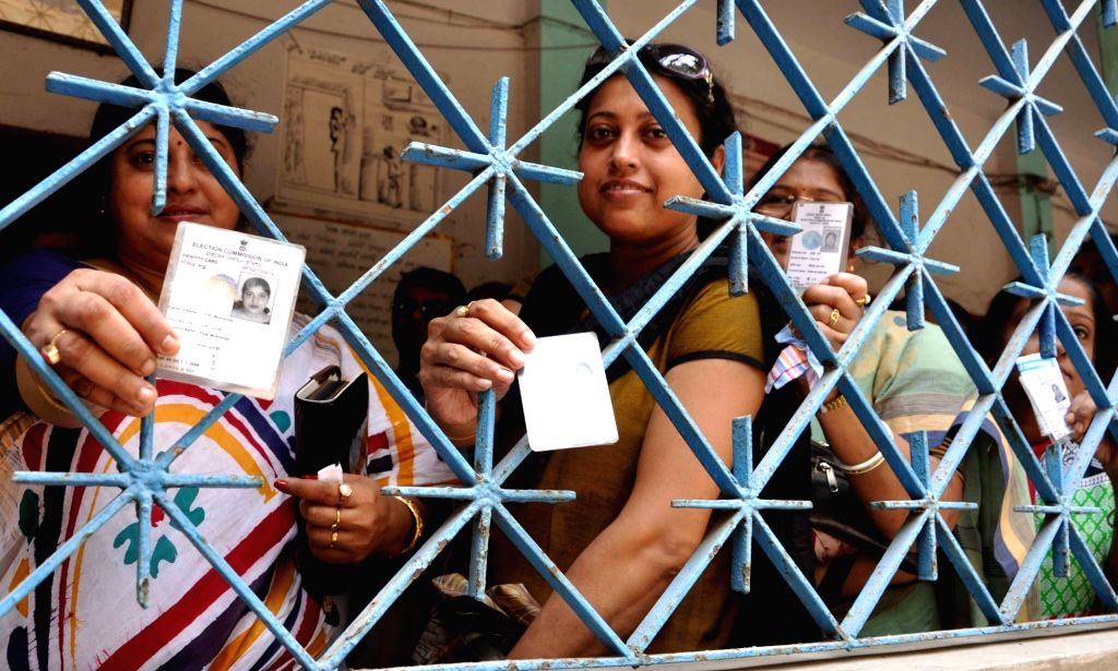 Kolkata: Women show their voter ID cards as they wait in a queue to cast their vote at a polling booth during the fifth phase of West Bengal Legislative Assembly polls in Kolkata, on April 30, 2016. (Photo: Kuntal Chakrabarty/IANS)